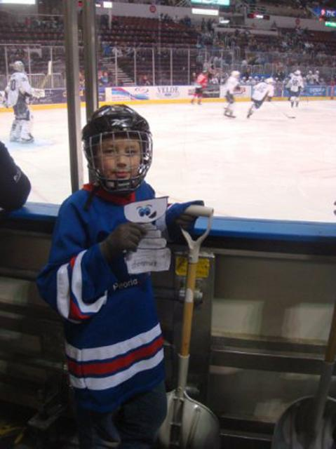 Ethan Mallinson takes Flat Stanley Cup to work with him during a Peoria Rivermen game where Ethan was Ice Crew for the night.: Photo submitted by Jodie Mallinson