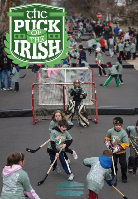 Temple Street in West Roxbury, Mass., is abuzz with activity as street hockey games are taking place for as far as the eye can see during the Shamrock Shootout.