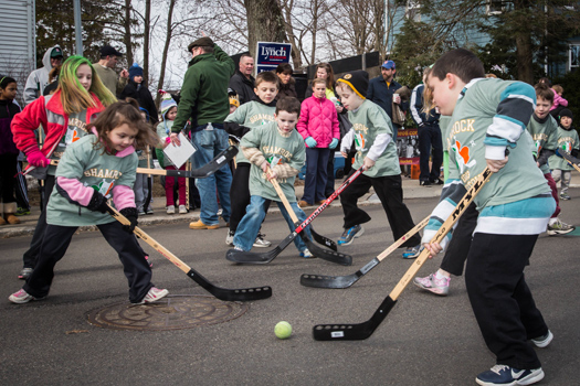The action starts early in the morning and goes all day as the entire community of West Roxbury, Mass., seems to come out to celebrate its Irish and hockey heritage.