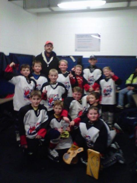 Here is Flat Stanley Cup in the locker room with the Canlan Squirt Lightning at Canlan's MLK Tournament in Fort Wayne, Ind.  The Lightning finished 2nd with an OT Championship loss.: Photo submitted by Rita Foster