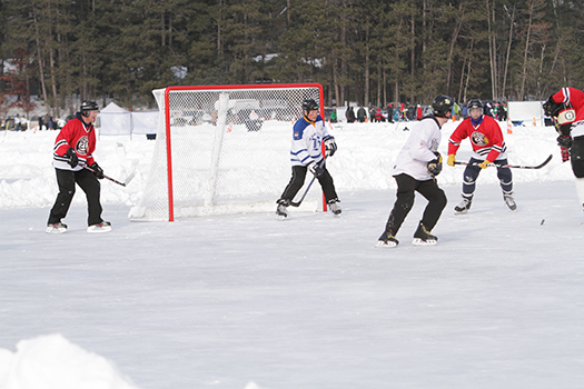 Adult hockey players were exhausted skating on a giant rink that ADM regional managers carved out on Dollar Lake in Eagle River, Wis.