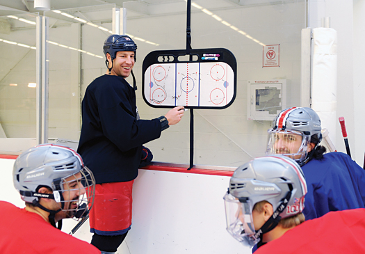 Ohio State alumnus R.J. Umberger shows members of the current Buckeyes team the right away to do things on the ice while he stays in shape in preparation for an NHL season.