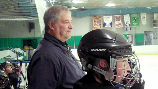 Lou Vairo helps out during a youth hockey game on Jan. 19 in Colorado Springs, Colo. Justin Felisko/USA Hockey Magazine