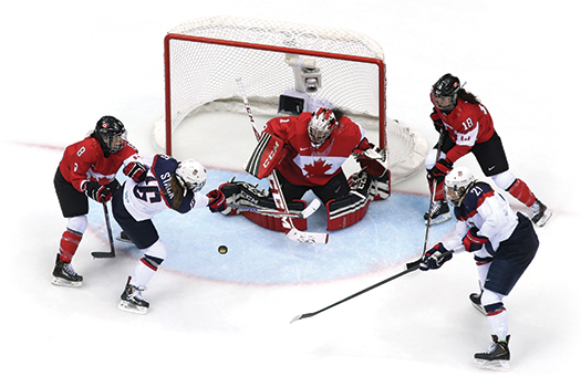 Hilary Knight and Kelli Stack storm the Canadian net.