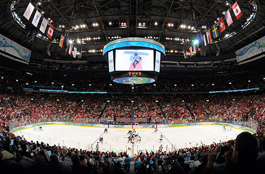 After competing on an NHL-sized rink in Vancouver, the Olympic competition returns to the bigger ice in Sochi.