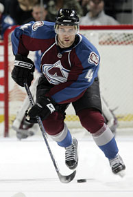 John-Michael Liles of the Colorado Avalanche keeps his head up to survey the ice as he leads the breakout.