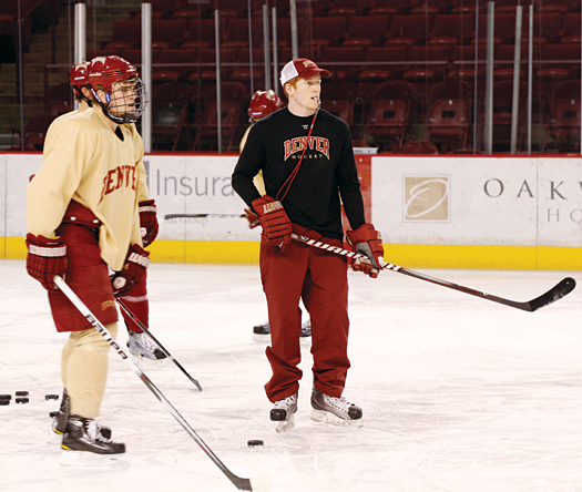 David Carle has become a valuable member of the DU coaching staff, helping head coach George Gwozdecky with everything from tutoring defensemen to creating practice plans.