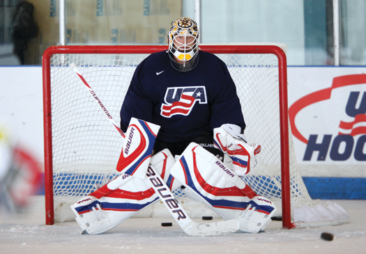 Boston Bruins goaltender Tim Thomas braces for practice shots during the U.S. Olympic Orientation Camp in suburban Chicago.