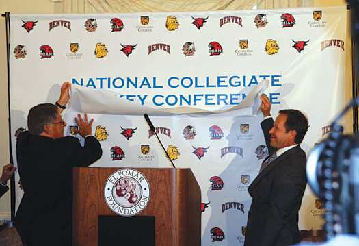 University of North Dakota Athletics Director Brian Faison, left, and University of Denver head coach George Gwozdecky unveil the newly formed National Collegiate Hockey Conference during a press conference in Colorado Springs.