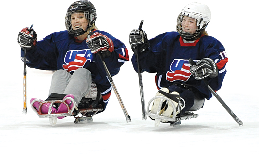Erica Mitchell, left, brings veteran leadership to the new women's sled hockey program.