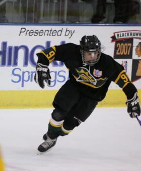 Jared Lowell races for the puck