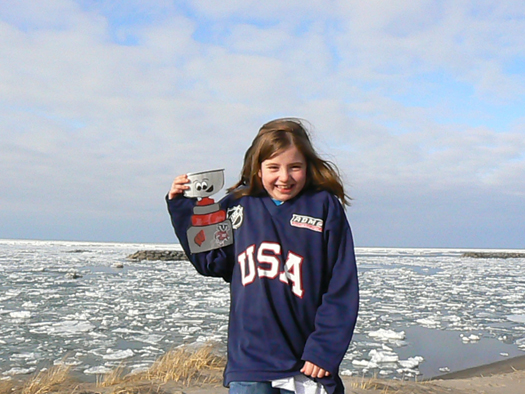 Flat Stanley Cup even made a trip to an eerily frozen Lake Erie with Sasha after she participated in the NCAA / USA Hockey American Development Model girls' clinic as part of the Frozen Four festivities.: Photo submitted by Erin Henderson