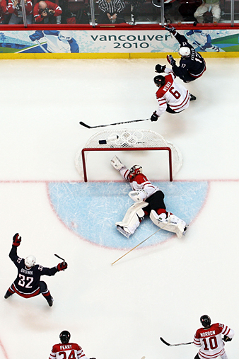 Dustin Brown, left, celebrates a goal by Ryan Kesler that got the Americans on the board against Roberto Luongo and the Canadians in the gold-medal game.