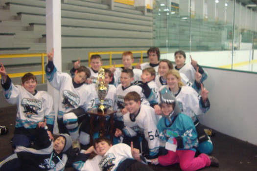 Flat Stanley Cup celebrates the Midstate Junior Sharks PeeWee 1 Team's division championship: Photo submitted by Ellen Ganley