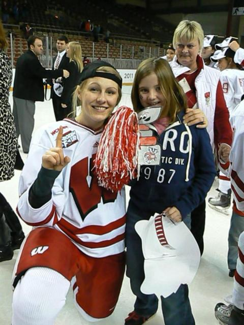 Sasha and Kelly Jaminski flash the #1 after another Badger Championship victory.: Photo submitted by Erin Henderson