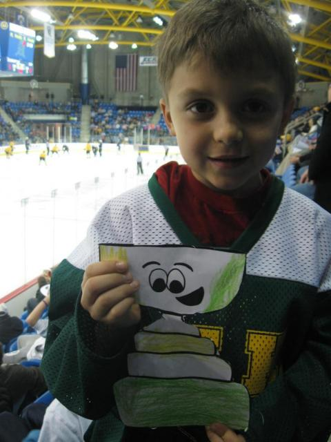 Owen Carson shows off his Flat Stanley Cup at a game between USA Under-18 & the Quinnipiac Bobcats in Hamden, Conn. Owen decorated his Stanley Cup using the colors of his Hamden Dragons clinic team.: Photo submitted by Eric Carson