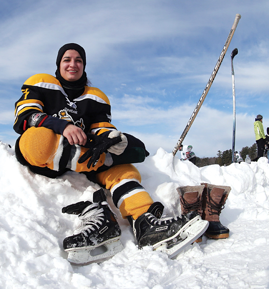 Liz Guilmet of the Yaks 1, squad finds a snowbank to get ready for her game.
