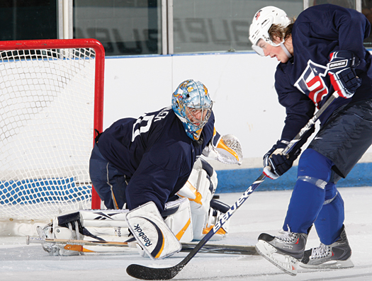 Ryan Miller stops T.J. Oshie during an Olympic Orientation Camp in Woodridge, Ill., in August.
