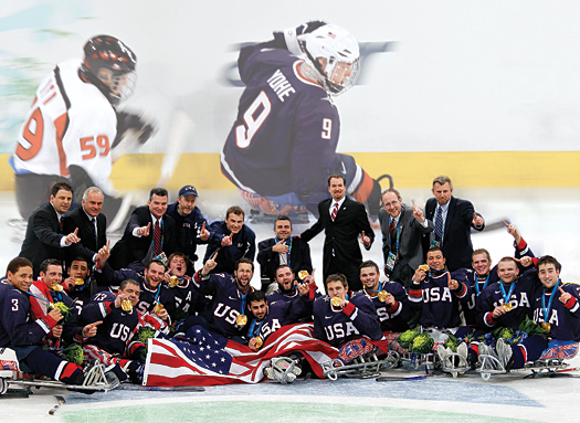 Players and staff from the U.S. Sled Hockey Team celebrate their impressive gold-medal victory at the 2010 Paralympic Winter Games in Vancouver.