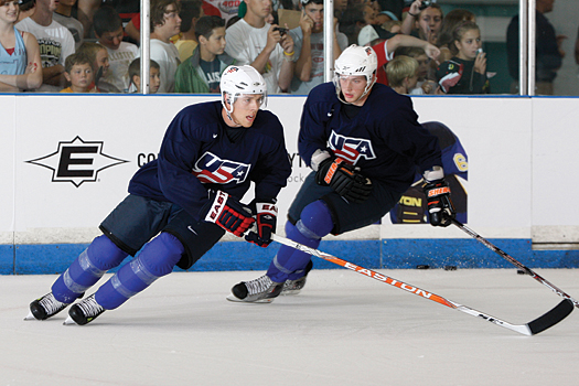 Joe Pavelski of the San Jose Sharks, left, and Bobby Ryan of the Anaheim Ducks shake the rust off during the first day of practice at the U.S. Olympic Orientation Camp in Woodridge, Ill.