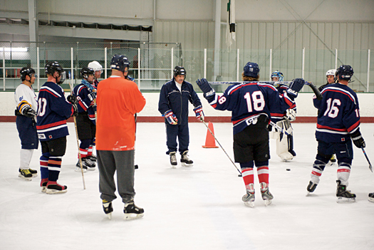 Head coach Steve Monahan puts the USA Warriors through their practice paces at the Kettler Capitals Iceplex in Arlington, Va.