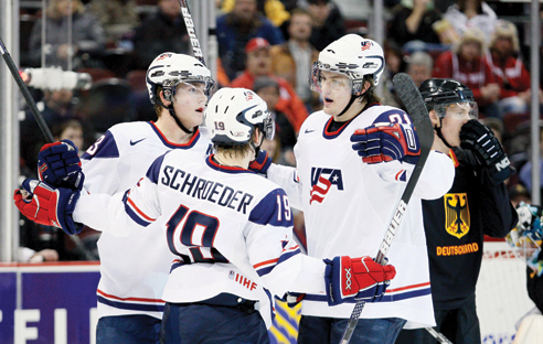 Colin Wilson and Jordan Schroeder celebrate a second period goal by James van Riemsdyk against Germany during the opening game of the 2009 IIHF World Junior Championship in Ottawa, Ontario.