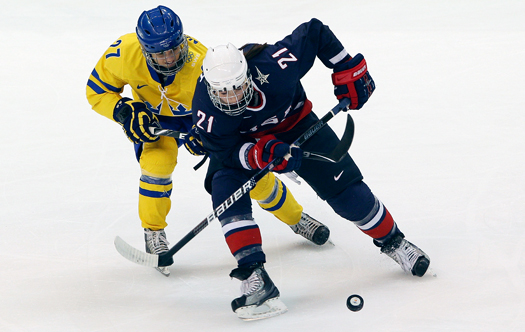 Hilary Knight looks to control the puck against Sweden in the semifinals.