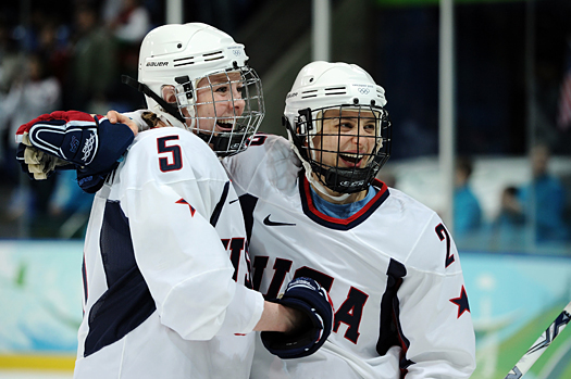 Karen Thatcher and Kerry Weiland celebrate a goal against Russia.
