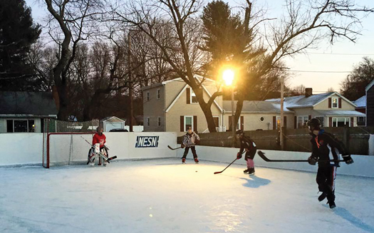Jay Craveiro has built a backyard frozen field of dreams that is enjoyed by his son, Samuel, and other neighborhood friends in Beverly, Mass.