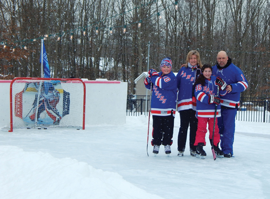 Mike Simon and his family show off their passion for the N.Y. Rangers on their home rink in Jackson, N.J.