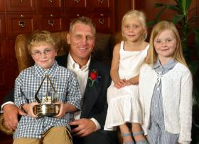 Jude and his sisters accompany their father to Colorado Springs, where Brett was honored by USA Hockey in 2003.