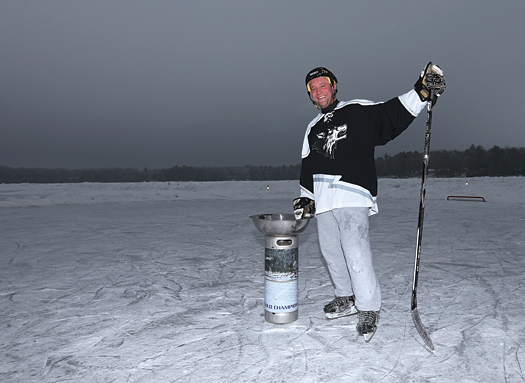 Ryan Blick of the Waupun Wolves celebrates their victory in Gold division at the 2013 USA Hockey Pond Hockey National Championships.