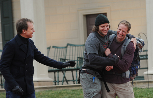 """Bates and Anthony Battaglia celebrate as they are greeted by """"Amazing Race"""" host Phil Keoghan after crossing the finish line at Mt. Vernon, Va."""