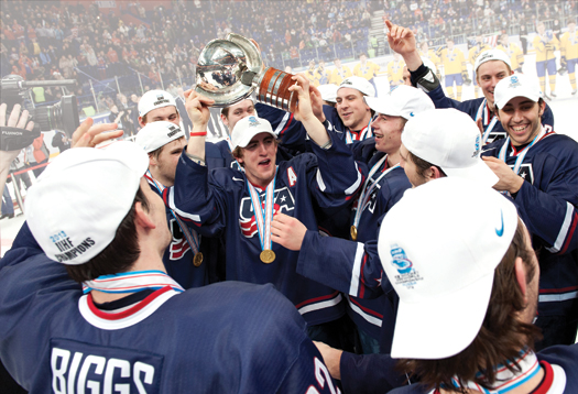 Cole Bardreau is mobbed by his teammates while hoisting the championship trophy following a 3-1 victory over Sweden in the gold-medal game at the 2013 IIHF World Junior Championship.