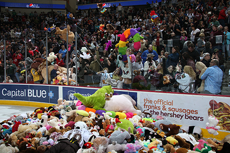 Shane Gersich (bottom) jumps into a legion of teddy bears. (JustSports photography)