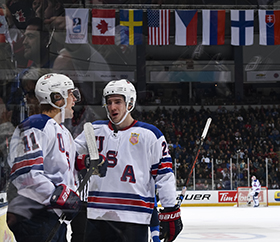 Poehling celebrating alongside Phil Kemp after his goal against Finland.